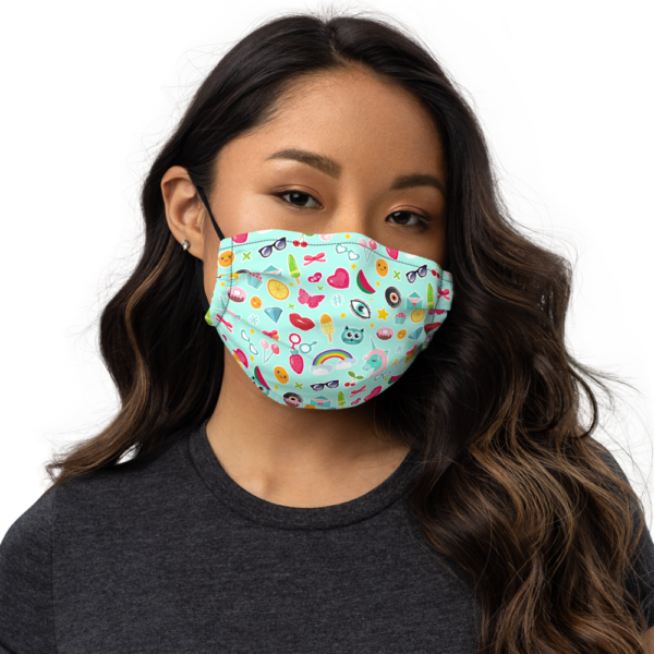 Women facing front, wearing face mask with funny pattern